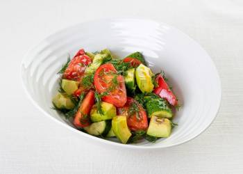 Salad with tomatoes, cucumbers and avocado