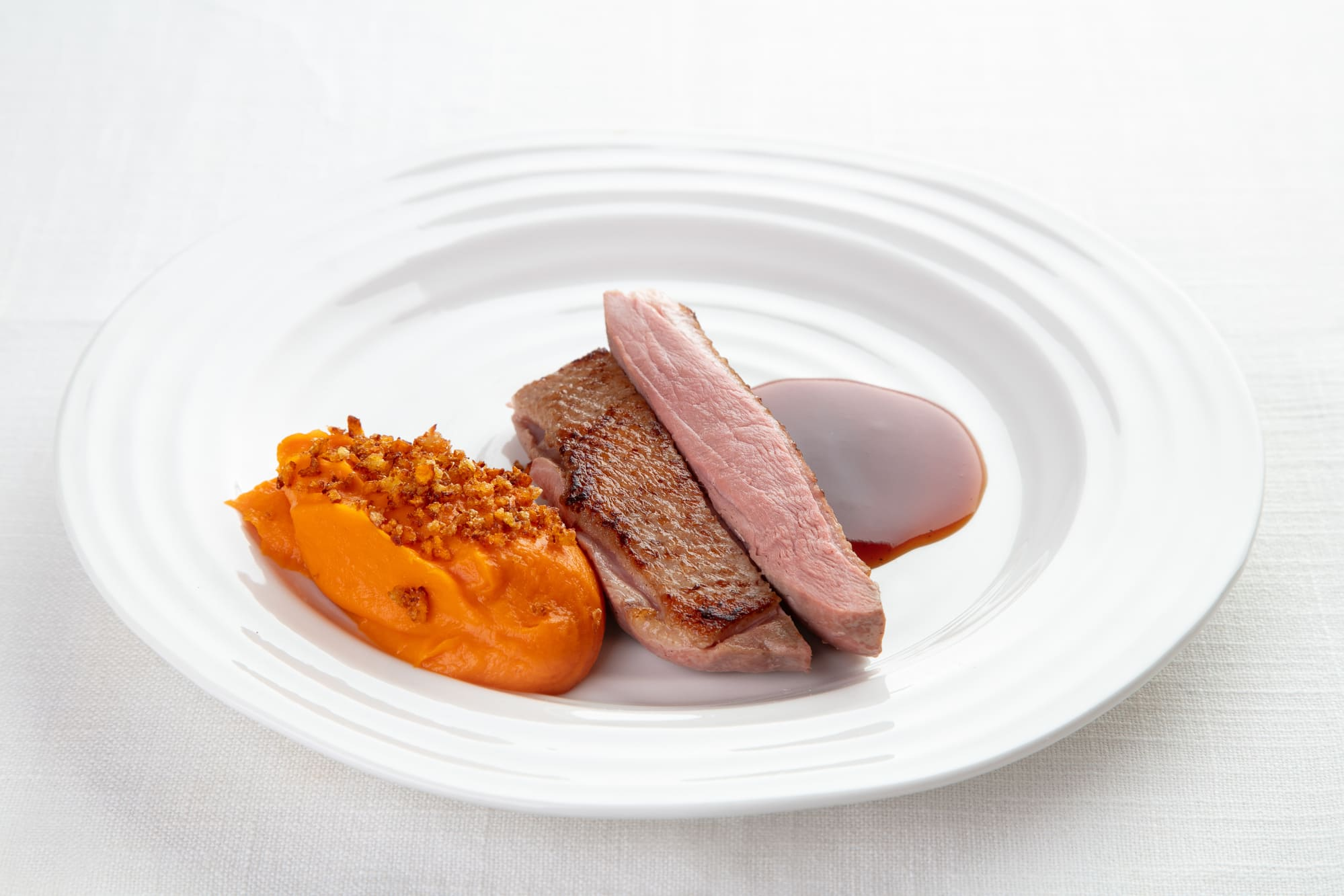 Duck breast with mashed sweet potato and BBQ sauce