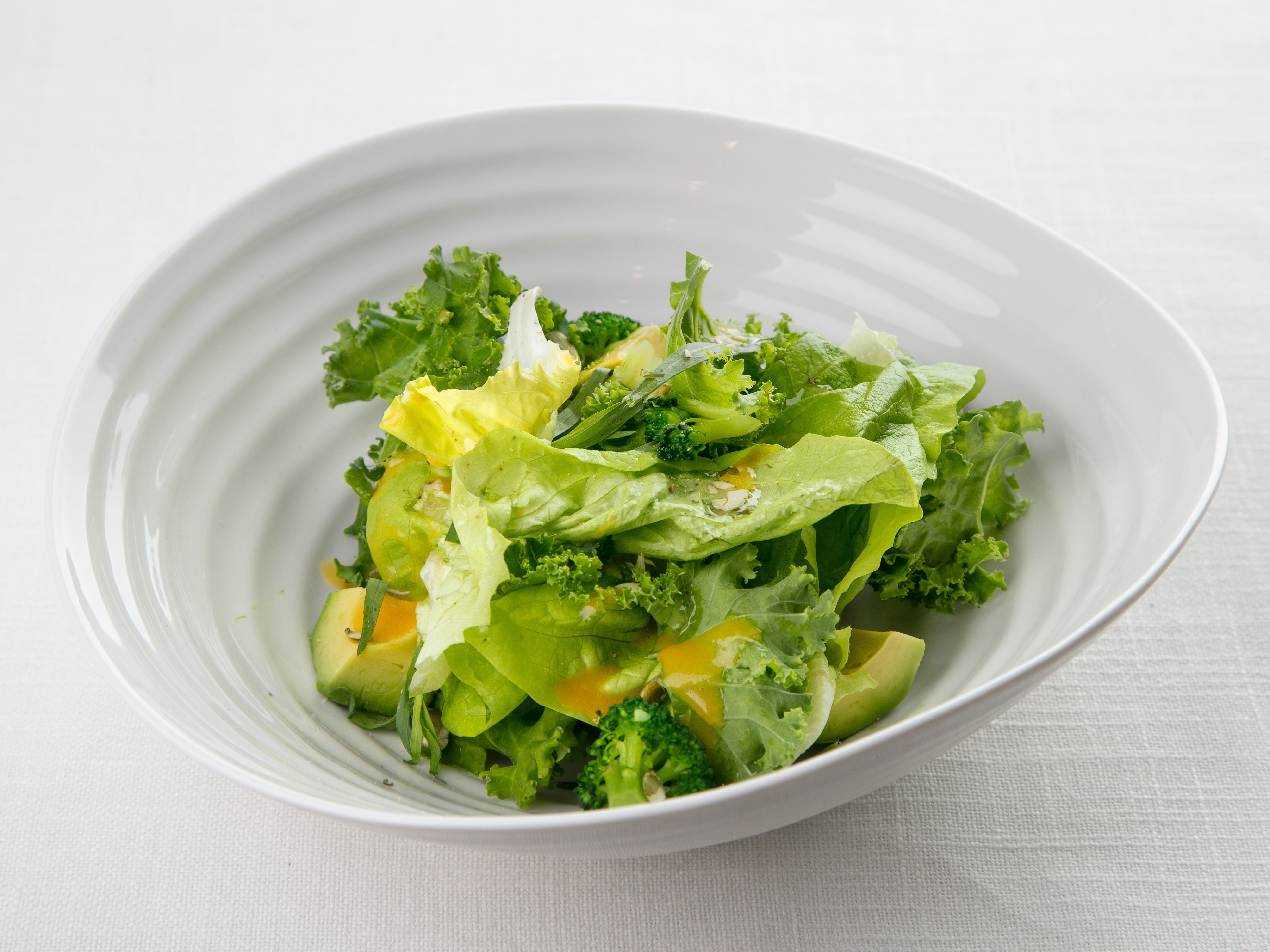 Salad with lettuce, kale, avocado and vegetable sauce